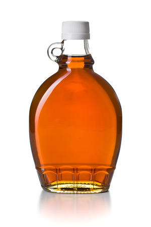 Photo for maple syrup in glass bottle on white background - Royalty Free Image