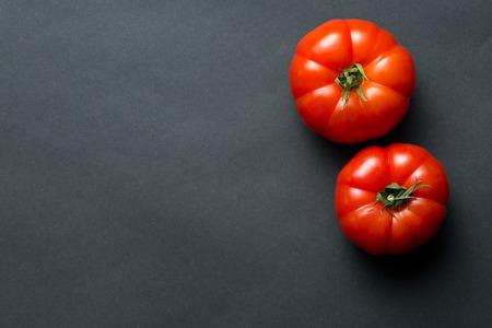 Photo pour the red tomatoes on black background - image libre de droit