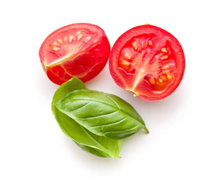 Photo pour chopped tomatoes and basil leaf on white background - image libre de droit