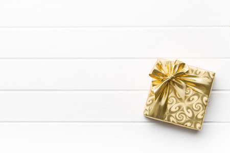 Photo for gold gift box on white table - Royalty Free Image