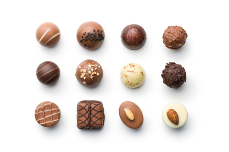 Photo for top view of various chocolate pralines on white background - Royalty Free Image
