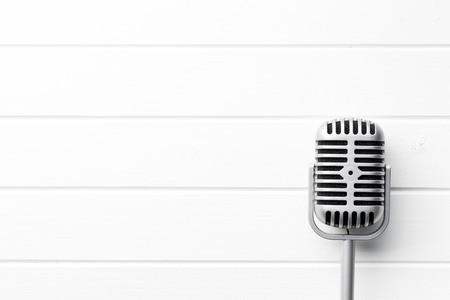 Photo for vintage microphone on white wooden background - Royalty Free Image