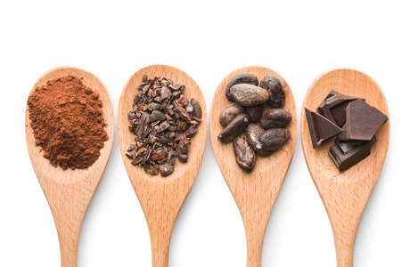 Photo for cocoa and dark chocolate in wooden spoons on white background - Royalty Free Image