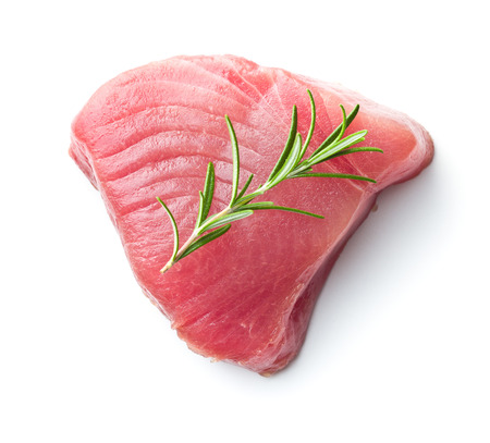 Foto de Fresh raw tuna steak and rosemary isolated on white background. - Imagen libre de derechos