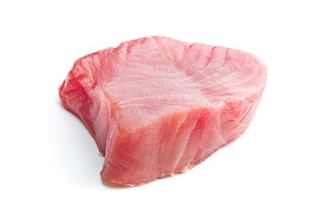 Foto de Fresh raw tuna steak isolated on white background. - Imagen libre de derechos