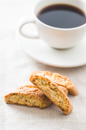 Photo for Sweet cantuccini biscuits. Italian biscotti and coffee cup. - Royalty Free Image