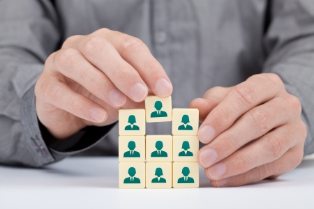 Photo pour Human resources and social networking concept - recruiter complete team by one person  employee  represented by icon   - image libre de droit