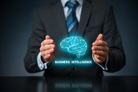 Photo pour Business intelligence (BI) concept. Businessman with icon of brain and text business intelligence in protective gesture. - image libre de droit