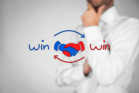 Win-win partnership strategy concept. Businessman think about drawn win-win strategy represented by scheme with handshake partnership agreement.