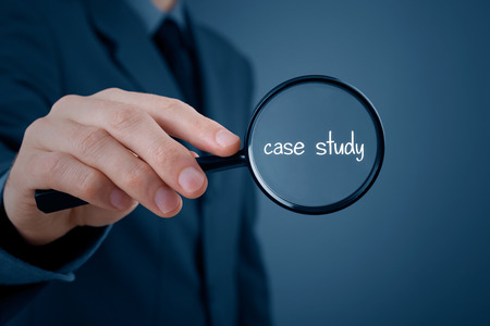 Foto de Businessman focused on case study. Businessman enlarge handwritten text case study. - Imagen libre de derechos