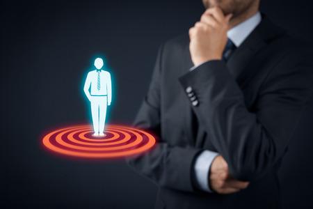 Foto de Target customer (marketing) concept. Businessman think about target customer represented by virtual icon of man standing on target. - Imagen libre de derechos