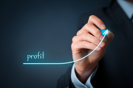 Foto de Increase profit concept. Businessman plan (predict) profit growth represented by graph. - Imagen libre de derechos