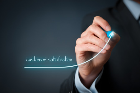 Foto de Increase customer satisfaction concept. Businessman (marketing specialist) draw growing line symbolize growing customer satisfaction. - Imagen libre de derechos