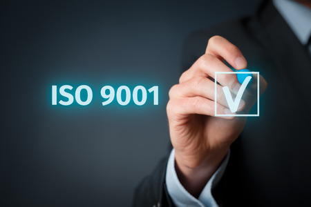 Foto de ISO 9001 - quality management system. Businessman select ISO 9001 certification. - Imagen libre de derechos
