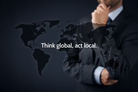 Photo pour Think global, act local. Globalization business rule. Businessman think about this rule. - image libre de droit