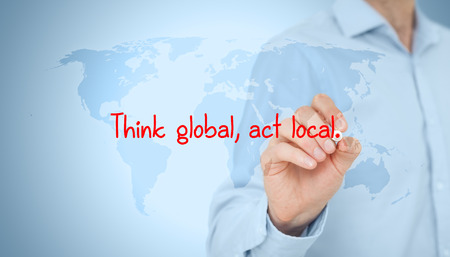 Photo pour Think global, act local. Globalization business rule. Businessman draw this rule on virtual board. - image libre de droit