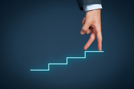 Foto de Manager (businessman, coach, leadership) has success and want to growth further. Growth and personal development represented by stairs. - Imagen libre de derechos