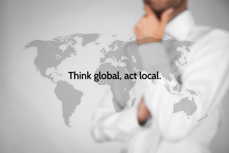 Foto für Think global, act local. Globalization business rule. Businessman think about this rule. - Lizenzfreies Bild