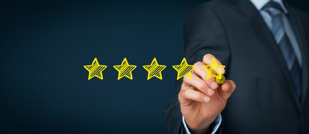 Photo pour Increase rating, evaluation and classification concept. Businessman draw five yellow star to increase rating of his company. Wide banner composition. - image libre de droit