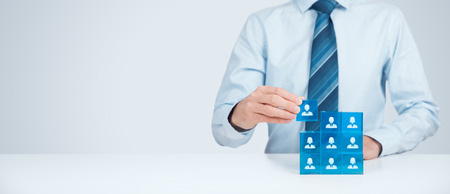 Photo pour Employees are represented by blue glass cubes with icons. Wide banner composition. - image libre de droit