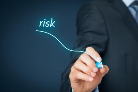 Photo pour Risk management concept. Businessman (risk manager) draw descending curve in graph to reduce corporate risk. - image libre de droit