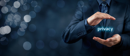 Photo pour Privacy policy concept. Businessman with protective gesture and text privacy in hands. Wide banner composition with bokeh in background. - image libre de droit