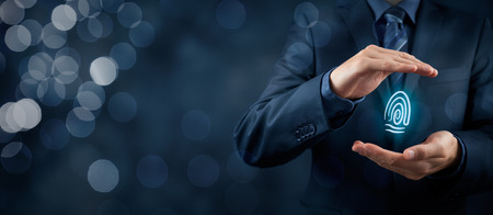 Photo for Privacy policy and security concepts. Protect your individuality in business. Businessman with protective gesture and fingerprint in hands. Wide banner composition with bokeh in background. - Royalty Free Image
