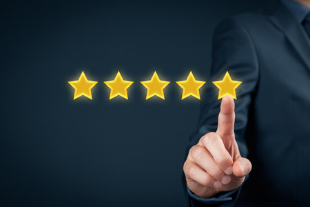 Foto de Review, increase rating or ranking, evaluation and classification concept. Businessman click on five yellow stars to increase rating of his company. - Imagen libre de derechos