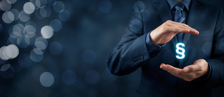 Photo pour Lawyer (advocate, jurist) help protect rights. Law represented by paragraph symbol. - image libre de droit