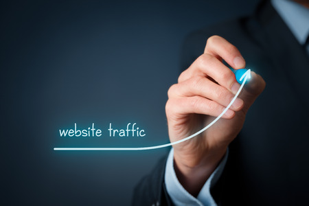 Foto de Website traffic improvement concept. Businessman draw increasing graph with text website traffic. - Imagen libre de derechos