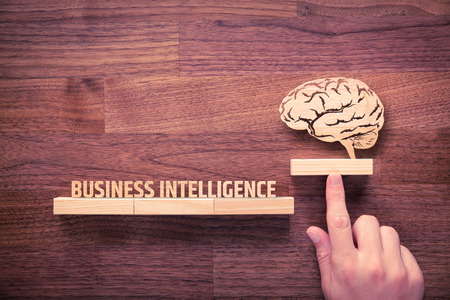 Photo pour Business intelligence (BI) concept. Businessman with icon of brain and text business intelligence. - image libre de droit