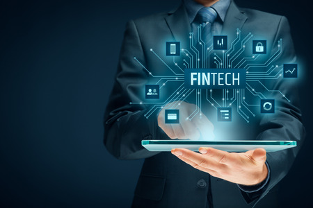 Foto de Fintech (financial technology) concept. Business person with tablet and fintech illustration. - Imagen libre de derechos