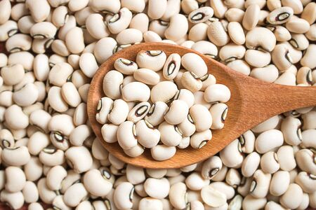 Photo for Black eyed beans in wooden  spoon. Black eyed peas has health benefits, Good for helps weight loss and relieving constipation. - Royalty Free Image