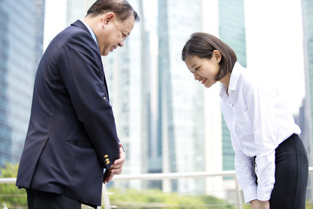 Photo for Asian businessman and young female executive bowing - Royalty Free Image