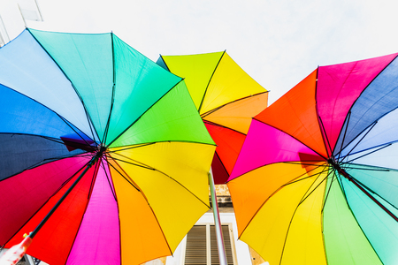 Foto de Colorful umbrellas to use as a background in bright and cheerful ideas. - Imagen libre de derechos