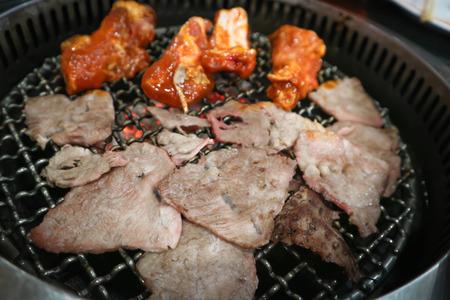 Foto de barbecued beef or grilled beef in the roaster - Imagen libre de derechos