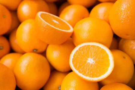 Photo for Closeup of sliced oranges on a market - Royalty Free Image