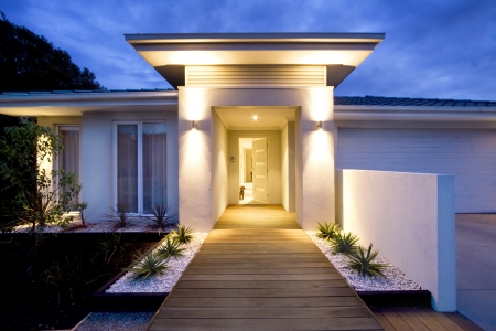 Grand entrance of a contemporary home at dusk