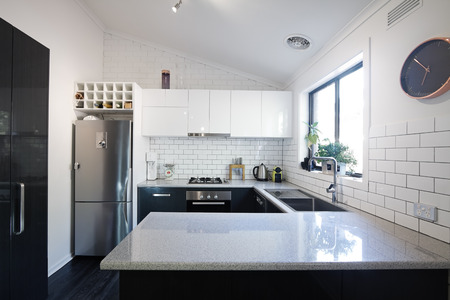Foto de New black and white contemporary kitchen with subway tiles splashback - Imagen libre de derechos