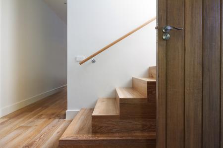 Foto de Modern staircase of oak wood beside front door in contemporary home horizontal - Imagen libre de derechos