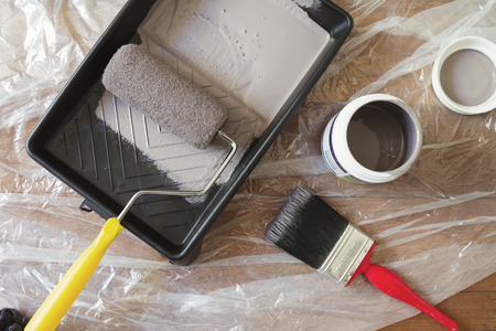Photo pour Overhead view of home painting equipment brush roller tray and paint pot - image libre de droit