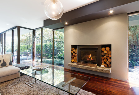 Foto de Blazing fire in living room of luxury architect designed Australian house - Imagen libre de derechos