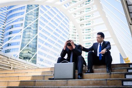 Foto de Asian Businessman feel sad and frustrated upset fail in life. - Imagen libre de derechos