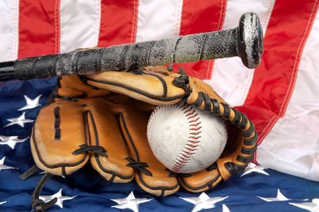 A baseball glove baseball and bat on an American flag symbolizing a traditional American s mural