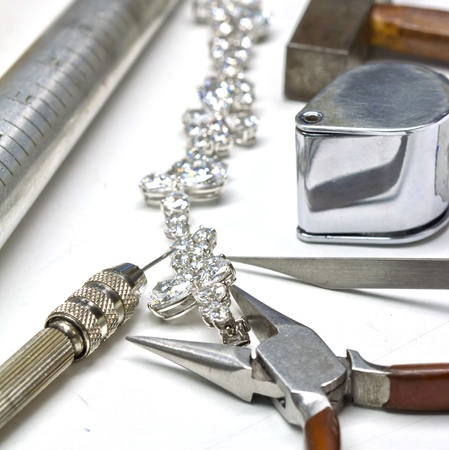 Photo pour Bracelet with diamond and repairing jewelry tools  loupe,wrench,pliers,hammer  - image libre de droit