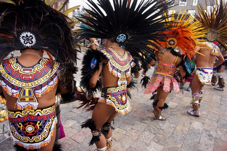 Photo for MEXICO CITY, MEXICO  December 12, 2015: Unknown Aztec dancers performing at the Our Lady of Guadalupe shrine celebrating Mexicos patron saints festival - Royalty Free Image