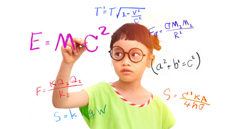 Foto de Little girl genius working on a mathematical equation - Imagen libre de derechos