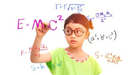 Photo pour Little girl genius working on a mathematical equation - image libre de droit