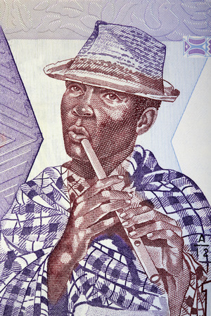 Photo for Malagasy flute player with a hat, a portrait from Malagasy money - Royalty Free Image