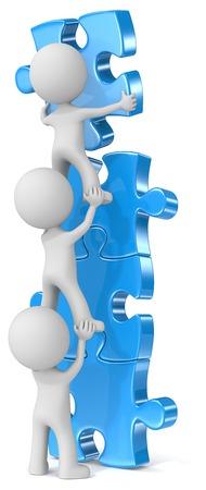 Foto de Effort and result. The dude x 3 building blue puzzle tower. - Imagen libre de derechos
